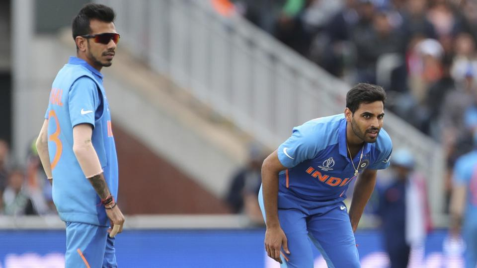 India's Bhuvneshwar Kumar, right, bends in pain after bowling a delivery during the Cricket World Cup match between India and Pakistan at Old Trafford in Manchester, England, Sunday, June 16, 2019. (AP Photo/Aijaz Rahi)