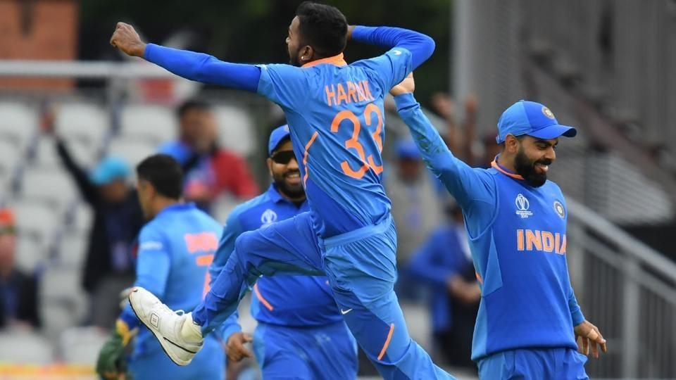 India's Hardik Pandya (C) leaps into the air as he celebrates with teammates after the dismissal of Pakistan's Shoaib Malik. (AFP)