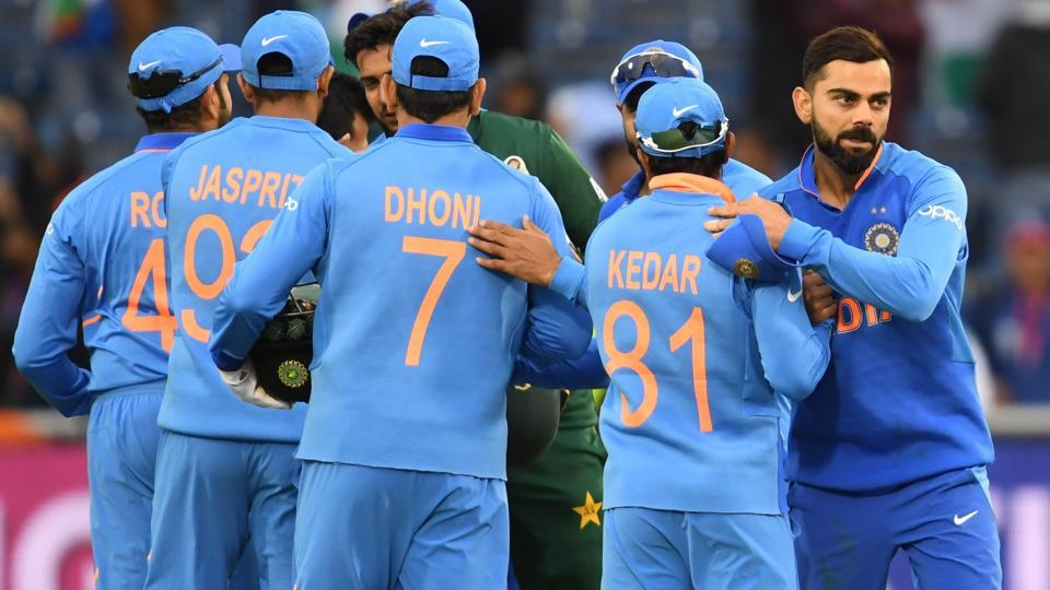 India's captain Virat Kohli (R) celebrates with teammates after victory in the 2019 Cricket World Cup group stage match between India and Pakistan at Old Trafford in Manchester