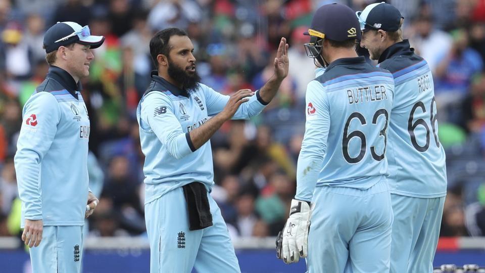 England's Adil Rashid, second left, celebrates with teammates the dismissal of Afghanistan's Asghar Afghan. (AP)