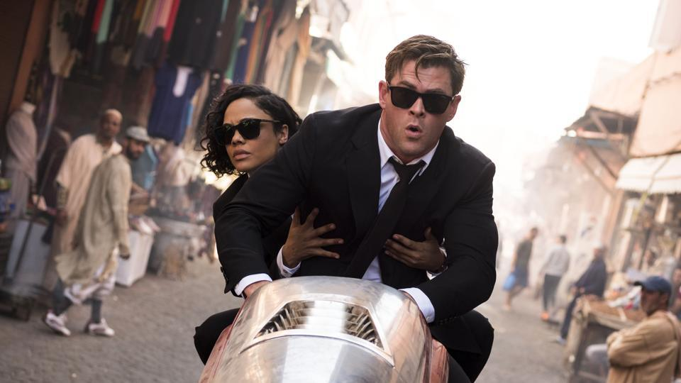 This image released by Sony Pictures shows Chris Hemsworth, foreground, and Tessa Thompson in a scene from Columbia Pictures' Men in Black: International.