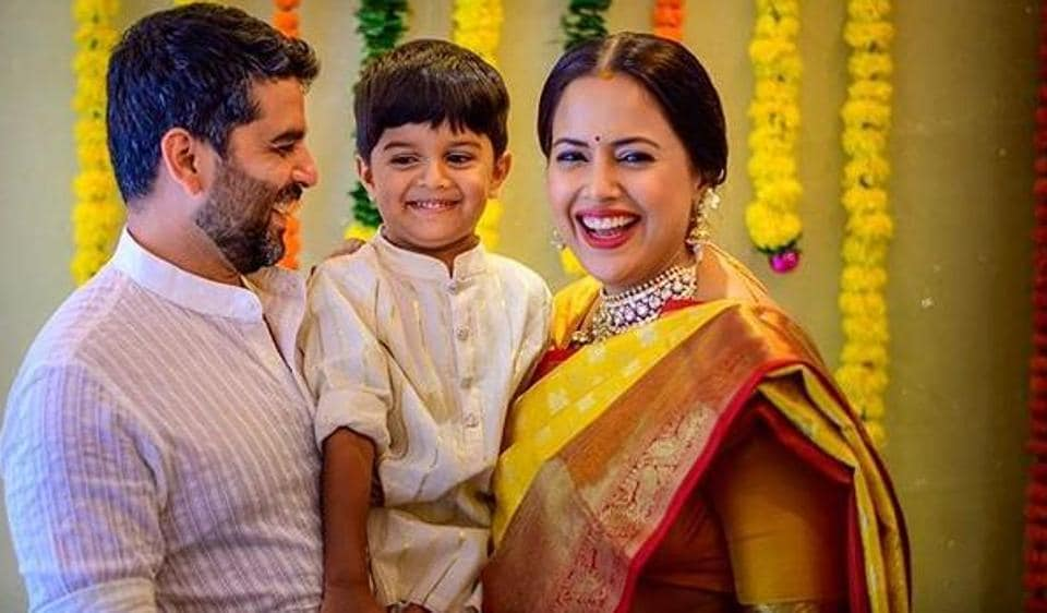 Sameera Reddy poses with her family during her traditional god bharai ceremony.