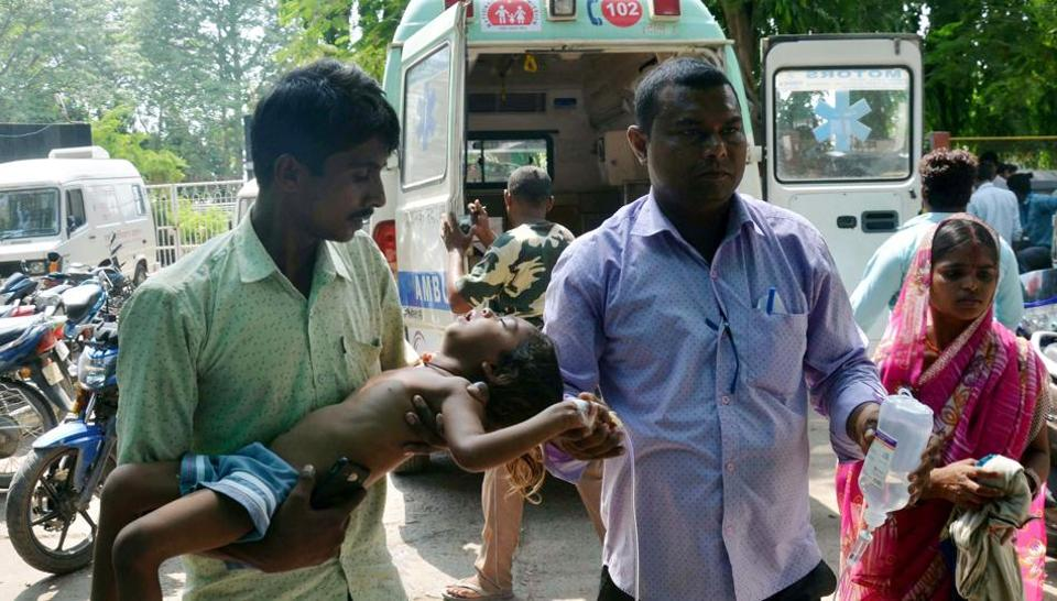 Family members bring their child to the hospital on the symptoms of Acute Encephalitis Syndrome (AES) in Muzaffarpur on June 19, 2019. (ANI Photo)