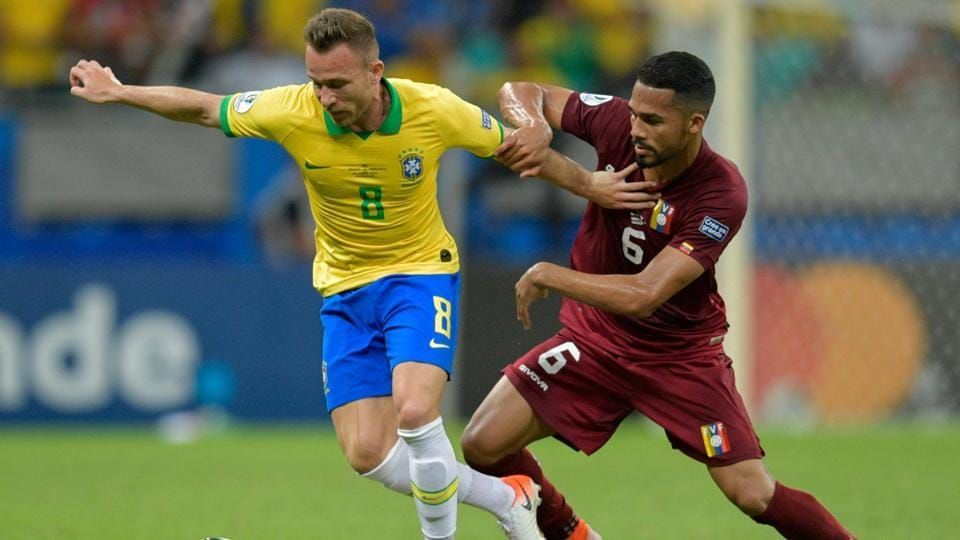 Brazil's Arthur (L) and Venezuela's Yangel Herrera vie for the ball during their Copa America football tournament group match at the Fonte Nova Arena in Salvador, Brazil, on June 18, 2019.