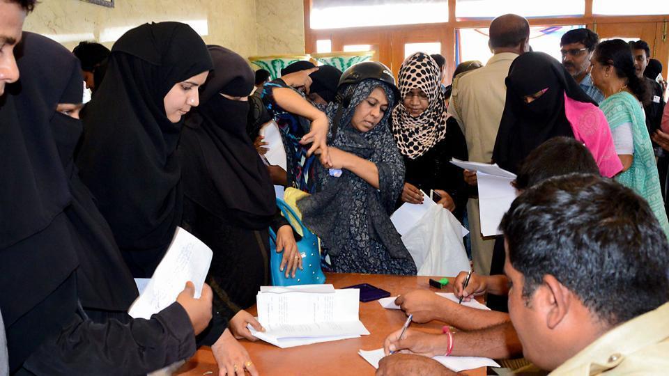 Muslim investors register their complaints against IMA (I Monetary Advisory) jewellery fraud at a temporary police post set up at Shivajinagar, in Bengaluru, Wednesday, June 12, 2019.