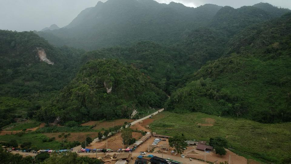 There has been extraordinary global interest in the picturesque rural backwater of Mae Sai since 12 youngsters -- aged between 11 and 16 -- and their coach entered the Tham Luang cave on June 23, 2018. They quickly became trapped by rising water levels and the daring, unprecedented mission to extract them through twisting flooded passageways captivated the world for 18 nail-biting days. (Lilian Suwanrumpha / AFP)