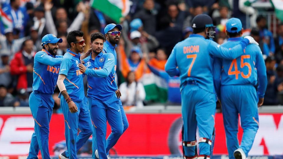 India's Kuldeep Yadav celebrates the wicket of Pakistan's Babar Azam.