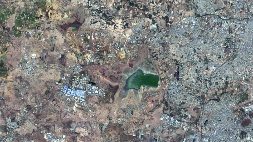 This June 15, 2019, Copernicus Sentinel-2 Satellite image provided by Maxar Technologies shows Chembarambakkam Lake in Chennai, India during the drought. Millions of people are turning to water tank trucks in Tamil Nadu as house and hotel taps run dry because of an acute water shortage caused by drying lakes and depleted groundwater.