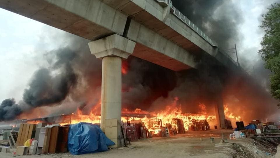 Trains on Delhi Metro's Magenta Line restarted after a massive fire raging for hours in a furniture market in Shaheen Bagh was put out on Friday, officials said. No injuries were reported in the fire, which had spread across the nearly 2,000square yard market. DMRC had said earlier that train services between Jasola Vihar and Kalindi Kunj were stopped temporarily because of the smoke and fire under the section. (Salman Ali / HTPhoto)