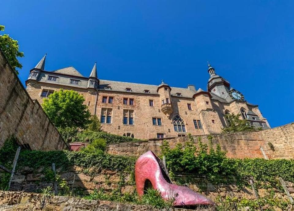 At the Marburg Castle, a larger-than-life Cinderella slipper waits indefinitely to be found.