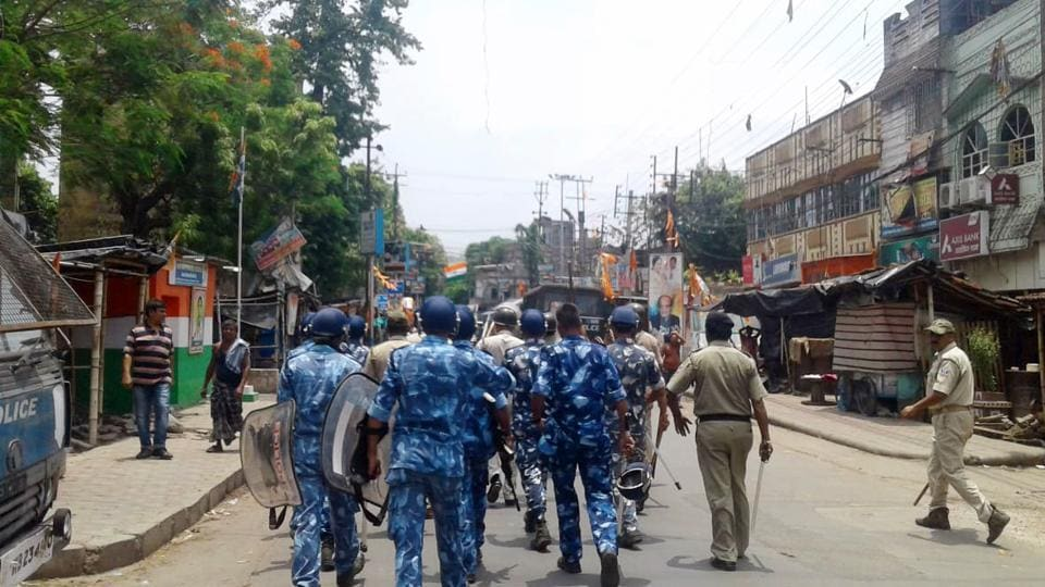 Paramilitary personnel march as a clash broke out between two groups in Bhatpara on Thursday.