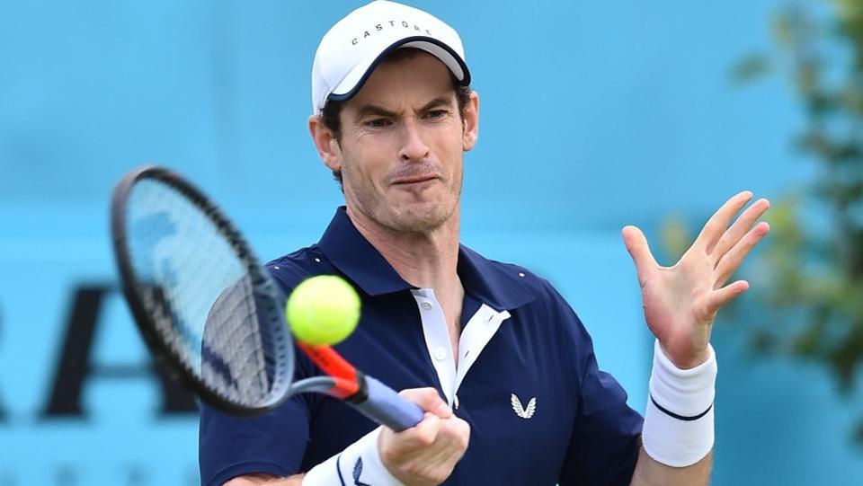 Britain's Andy Murray returns to Colombia's Juan Sebastian Cabal and Robert Farah.
