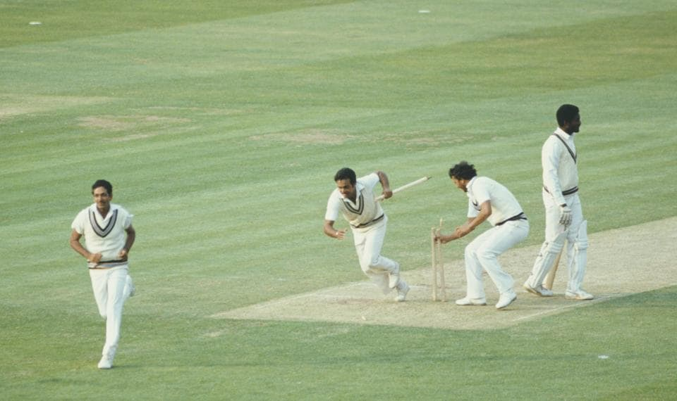 Victorious India players Yaspal Sharma and Roger Binny grab souvinir stumps as Mohinder Amarnath (l) runs off the field as West Indies batsman Michael Holding looks on after the 1983 Prudential World Cup Final victory against West Indies at Lords on June 23, 1983 in London, England. (Photo by Adrian Murrell/Allsport/Getty Images)