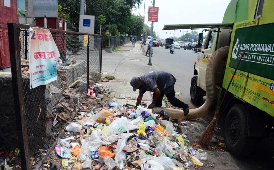 A worker of Adar Poonawala collecting garbage, mostly plastic waste, at Vimannagar.