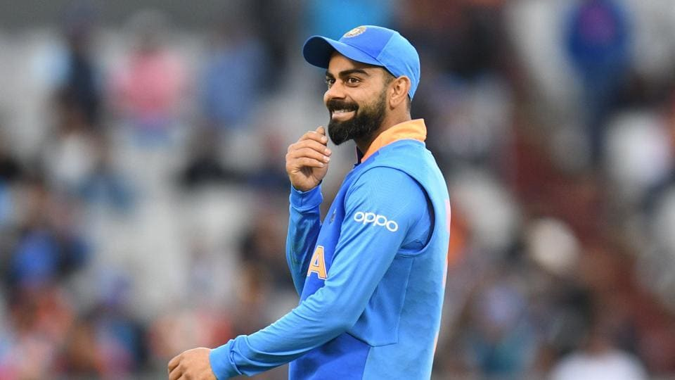 India's captain Virat Kohli gestures while fielding during the 2019 Cricket World Cup group stage match between India and Pakistan at Old Trafford in Manchester, northwest England, on June 16, 2019