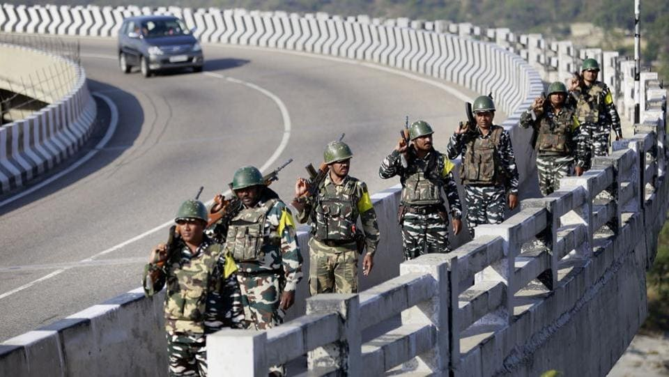 Central Reserve Police Force (CRPF) soldiers patrol the Jammu & Kashmir National Highway ahead of the upcoming Amarnath Yatra, in Jammu district. The 46-day-long Amarnath Yatra will begin on July 1 and would conclude on August 15. (PTI)