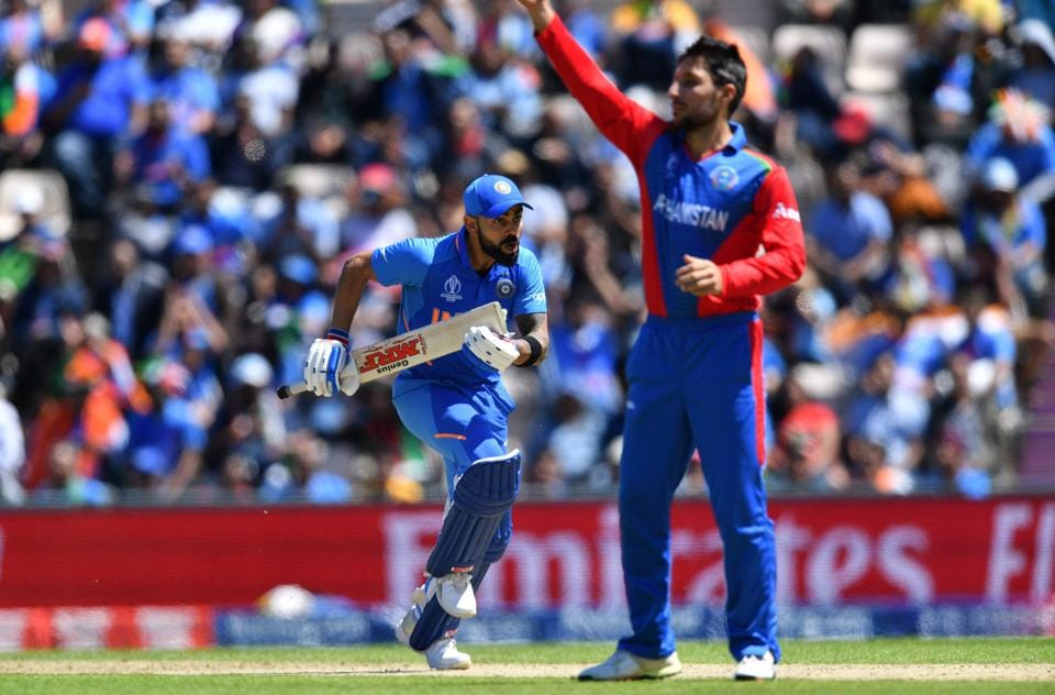 India's captain Virat Kohli (L) runs between the wickets.