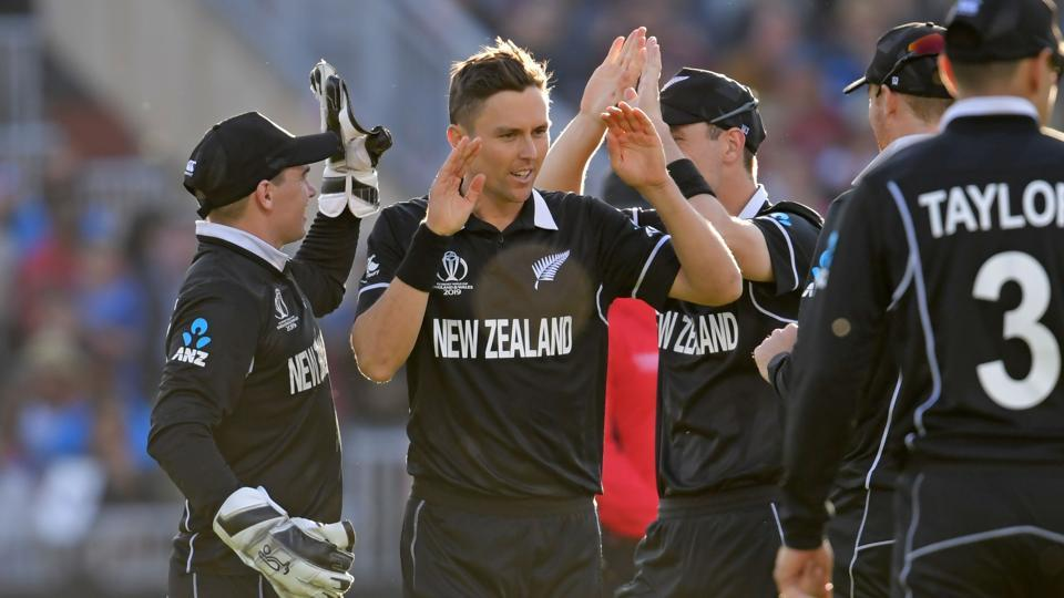 New Zealand's Trent Boult (C) celebrates with teammates after taking the wicket of West Indies' Ashley Nurse during the 2019 Cricket World Cup group stage match between West Indies and New Zealand at Old Trafford in Manchester, northwest England, on June 22, 2019 (AFP)
