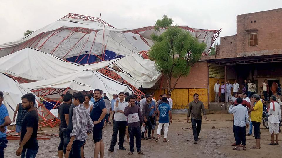 Fourteen people were killed and more than 50 others injured when a tent of a religious program collapsed during a dust storm in Barmer's Jasol village .