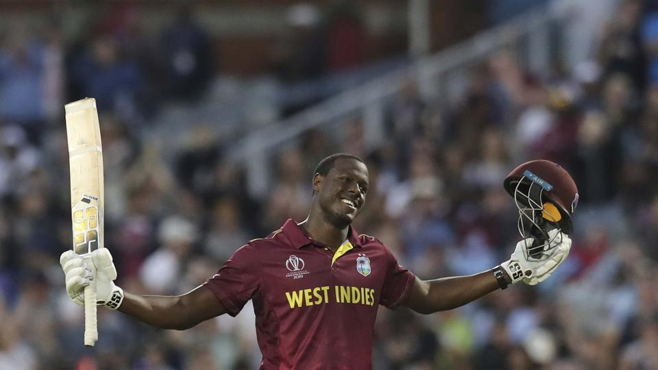 West Indies' Carlos Brathwaite celebrates after scoring a century during the Cricket World Cup match between New Zealand and West Indies at Old Trafford in Manchester, England, Saturday, June 22, 2019 (AP)