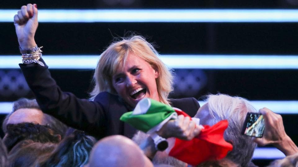 Member of the Italian delegation Diana Bianchedi reacts after the announcement.