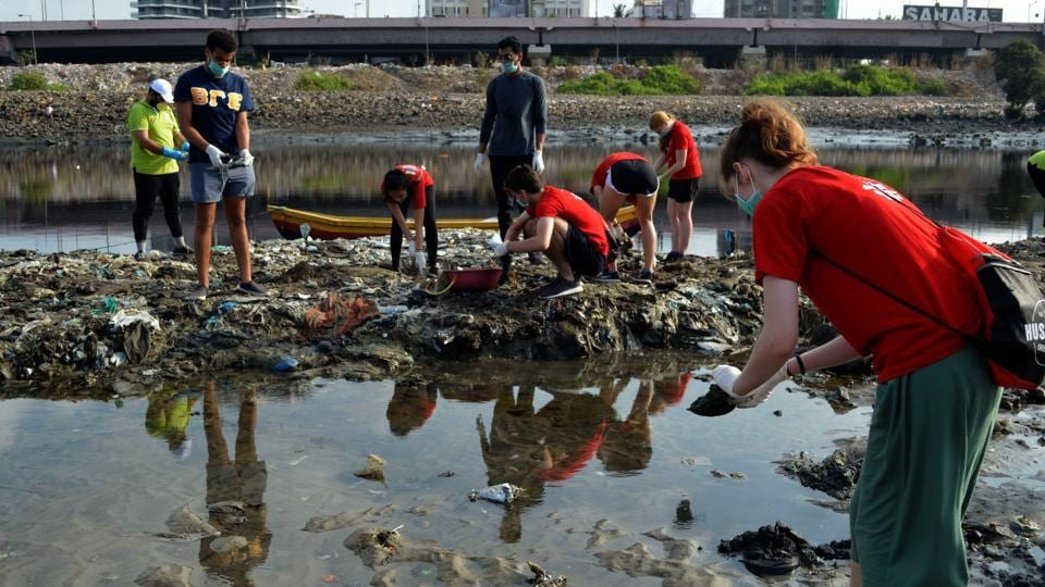Volunteers collecting plastic from Mithi river at Mahim Causeway, in Mumbai, on Wednesday, 5 June, 2019.