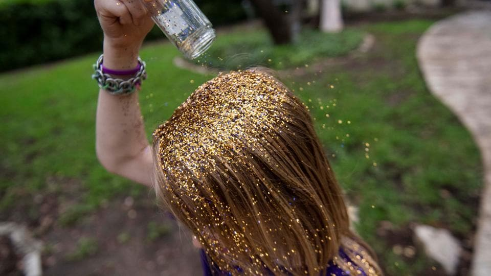 Keegan pours glitter on his head during his 9th birthday party at his home near Austin. The glitter party was inspired by a Queer Eye episode. Keegan's family says he was motivated to try drag after watching RuPaul's Drag Race. The degree of acceptance for such students can literally be a matter of life and death, experts say. (Amanda Voisard / REUTERS)