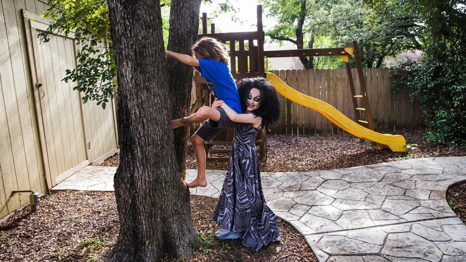 Keegan (R), plays with his older brother, Noah, 10, outside their family home following a drag lesson with his drag queen mentors. Keegan's parents say he often remains in full drag until bed time.  By one survey nearly 3% of youth in Minnesota fall under these categories, identifying with neither gender, or both, or trans, or just defying a traditional male/female binary option. (Amanda Voisard / REUTERS)