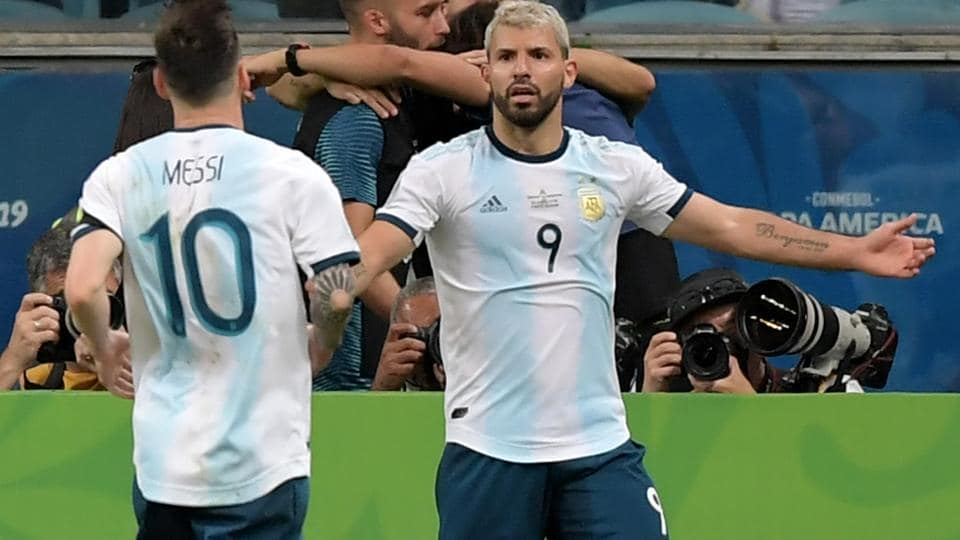 Argentina's Sergio Aguero (R) celebrates with Argentina's Lionel Messi after scoring against Qatar.