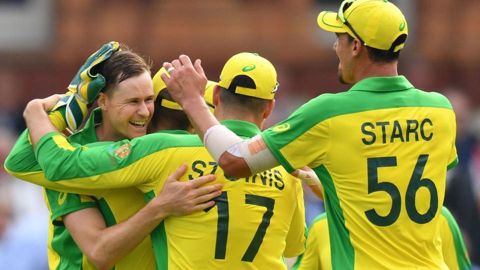 Australia's Jason Behrendorff (L) celebrates with teammates after the dismissal of England's Jofra Archer. (AFP)