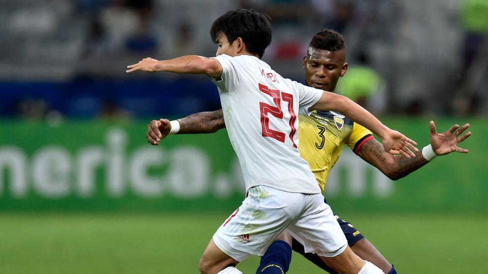 Japan's Takefusa Kubo and Ecuador's Robert Arboleda vie for the ball during their Copa America football tournament group match at the Mineirao Stadium in Belo Horizonte, Brazil, on June 24, 2019. (Photo by Douglas Magno / AFP)