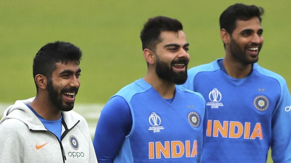India's captain Virat Kohli, center, Jasprit Bumrah, left, and Bhuvneshwar Kumar attend a training session.