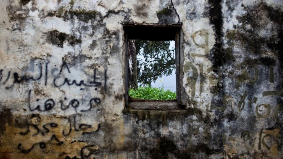 Across the Golan are other reminders of the 1967 and 1973 wars between Israel and Syria: minefields, foxholes and abandoned armour. One former Syrian building, crumbling and covered in graffiti, has this Arabic message reading: