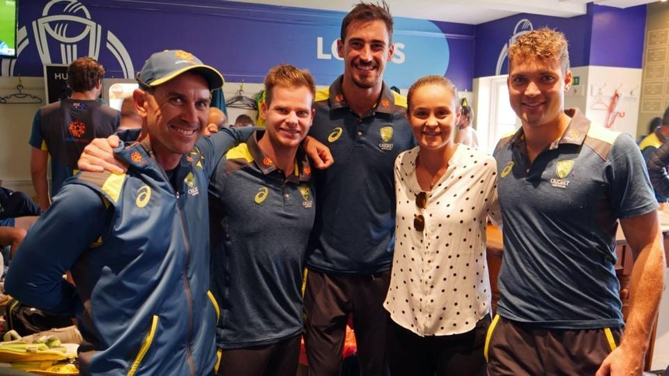 World Number 1 tennis player Ashleigh Barty of Australia with members of the Australia cricket team after their win over England in the ICC World Cup match at Lord's.