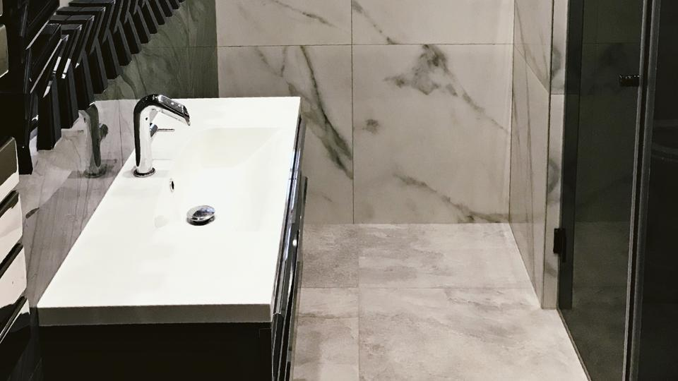 Some like to add gravitas to their bathroom interiors with fresh fragrant flowers and votive candles, while for others it's more about natural light and meticulously organised vanity cabinets.