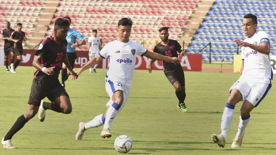 Players of Minerva Punjab FC (in black) and Chennaiyin FC (in white) in action during their AFC Cup Football match, at Indira Gandhi Athletics Stadium, Sarusajai in Guwahati, Wednesday, June 19, 2019.