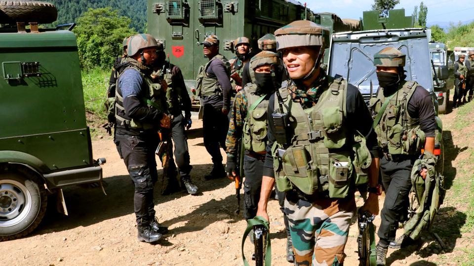 Army jawans walk towards encounter site at Branpatri, a forest area of Tral in Pulwama, on June 26, 2019. (ANI Photo)