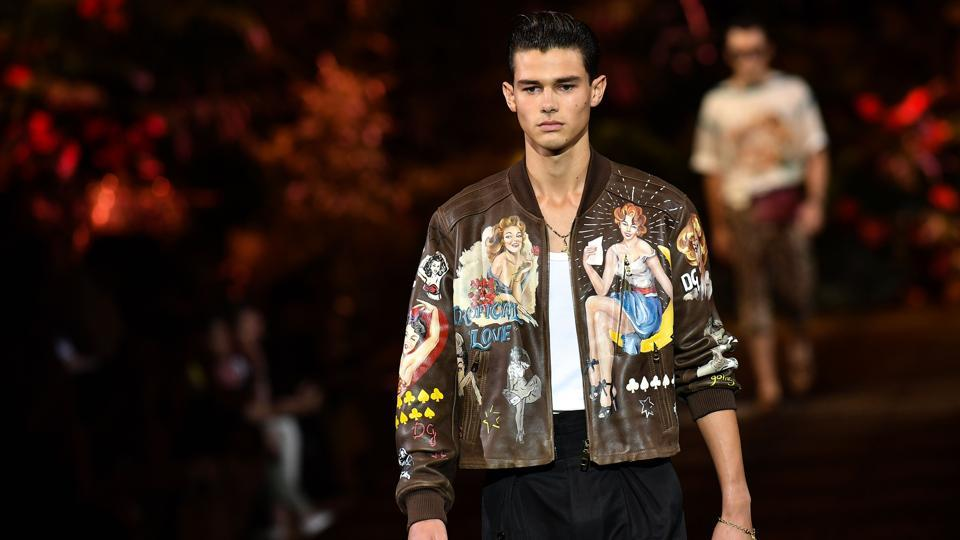 A model presents a creation for fashion house Dolce & Gabbana during the presentation of its men's spring/summer 2020 fashion collection in Milan on June 15, 2019. (Photo by Marco Bertorello / AFP)