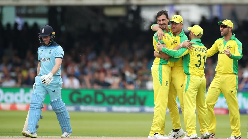 Mitchell Starc celebrates taking the wicket of England's Eoin Morgan