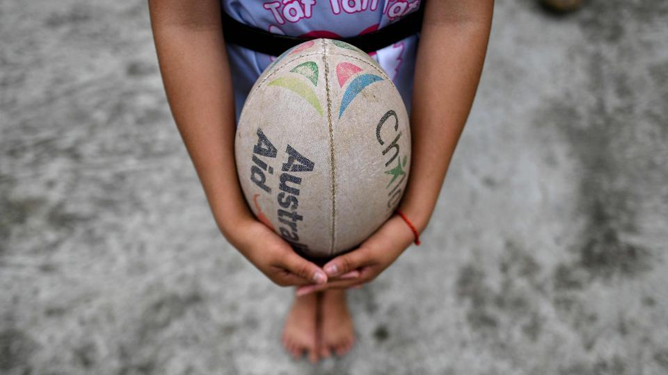 A girl holds a ball during a rugby clinic in the Kim Boi district of Vietnam's Hoa Binh Province. Few knew anything about rugby when they joined the scheme, marvelling at the egg-shaped ball, but are now keen fans planning to closely follow the Rugby World Cup in Japan, which starts in September. (Manan Vaytsyayana / AFP)