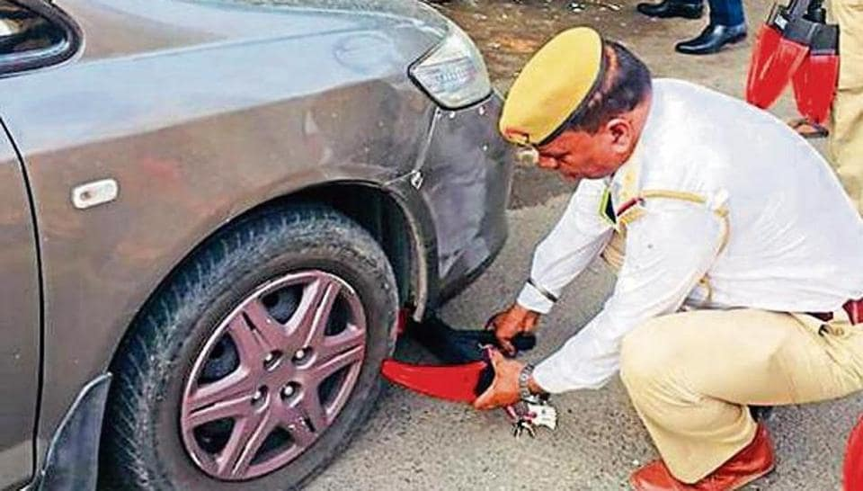 Wheel clamps, specially designed to prevent the movement of vehicles, bearing a traffic helpline number, will be used.