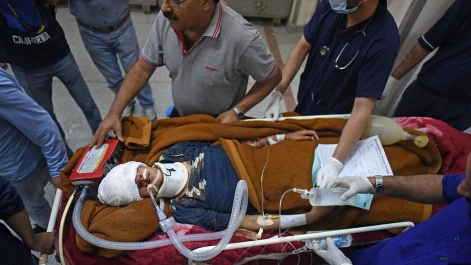 An injured  person is carried on a stretcher at a hospital in Srinagar,India, on June 27, 2019.