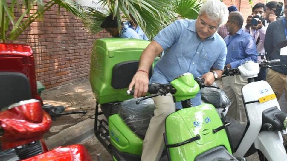 Transport Minister of Delhi Kailash Gahlot seen checking an electric motor bike during the inauguration of the Urban Mobility Lab workshop and launch of a pilot project, at India Habitat Centre