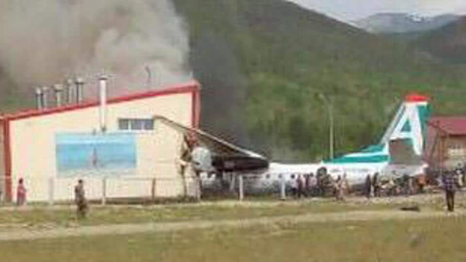An Antonov An-24 passenger plane is seen after an emergency landing in the town of Nizhneangarsk, Russia.