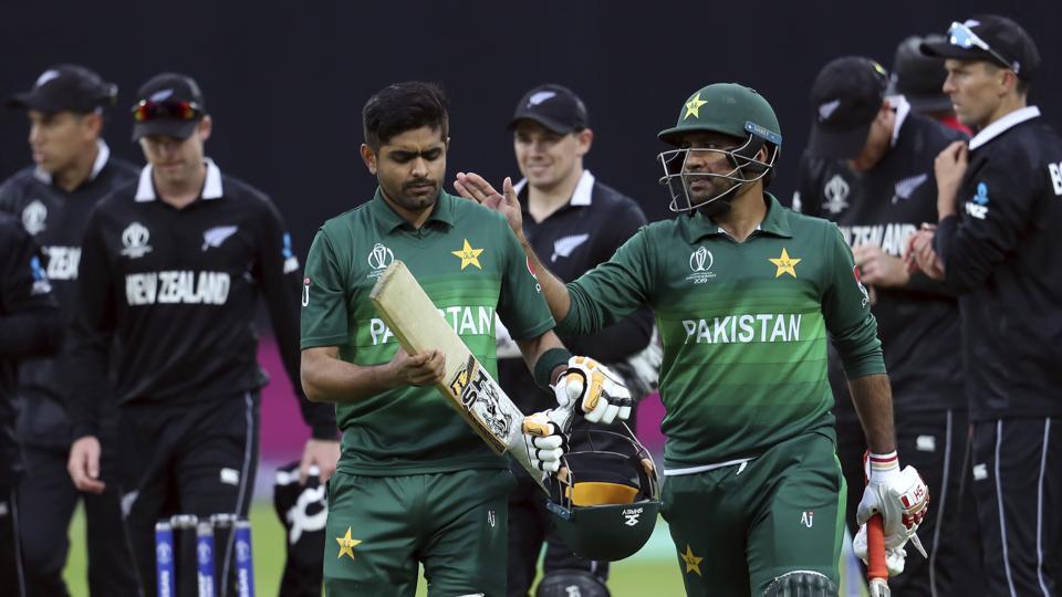 Pakistan's captain Sarfaraz Ahmed, right, pat on the shoulder teammate Babar Azam
