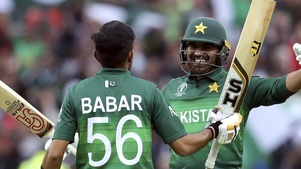 Pakistan's batsman Haris Sohail, right, embraces teammate Pakistan's batsman Babar Azam for scoring a century. (AP)