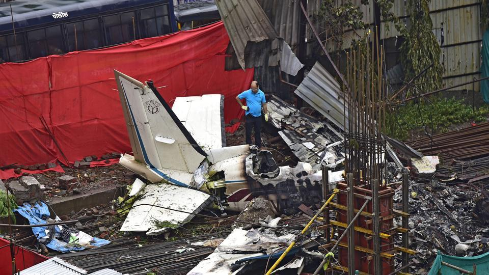 AAIB officials examine the site where a chartered plane crashed in Mumbai's Ghatkopar on Juen 28, 2018.