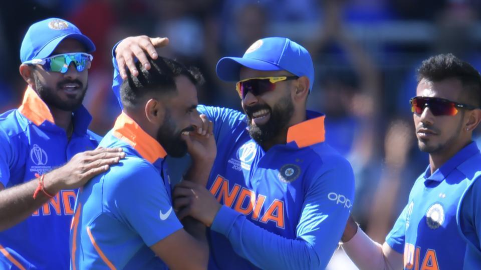India's Mohammed Shami (2L) celebrates with India's captain Virat Kohli (2R) after dismissing West Indies' Shai Hope.