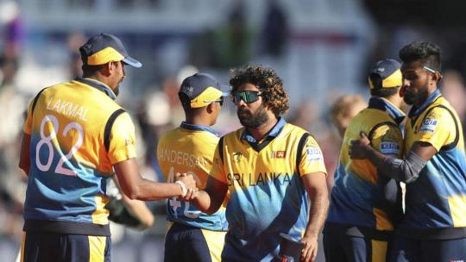 Sri Lanka's Lasith Malinga greets team mates after winning the ICC World Cup match against England in Leeds.