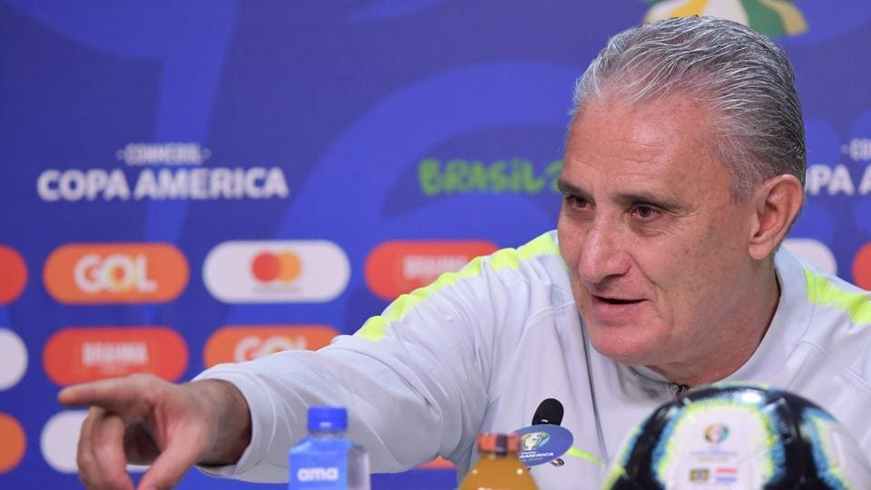 Brazil's coach Tite gestures as he speaks during a press conference in Porto Alegre, Brazil, on June 26, 2019, on the eve of the Copa America quarterfinal football match against Paraguay. (Photo by Luis Acosta / AFP)